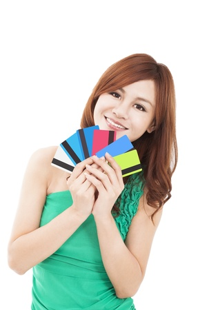 happy young woman holding credit cards Stock Photo - 17887827