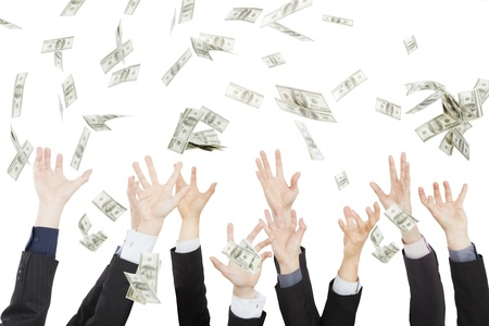 Many dollars falling on business people hand  Stock Photo - 17976117