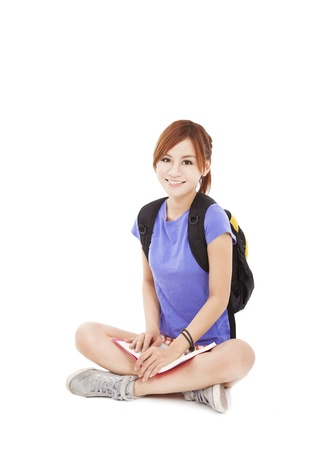 beautiful student girl reading book and sitting on floor  photo