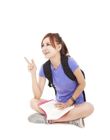 student girl reading book and pointing at something photo