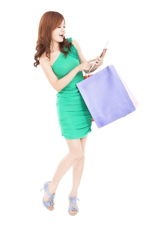 happy young woman shopping on the internet by tablet pc photo