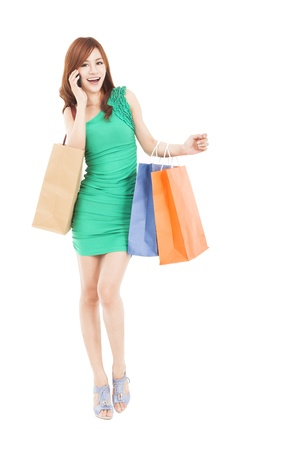 full length of asian woman with shopping bags talking on the phone Stock Photo - 18237728