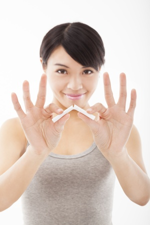 woman stop: young woman breaking cigarette and stop smoking Stock Photo