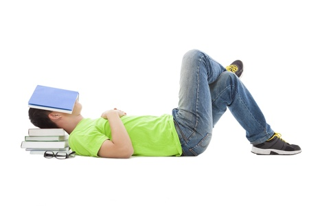 young student lying on the floor and sleeping Stock Photo - 18352841