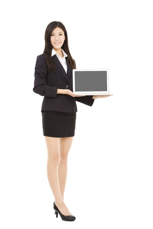full length of young businesswoman holding laptop Stock Photo - 18352839