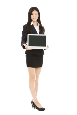 full length asian businesswoman holding laptop isolated on white background Stock Photo - 18352848