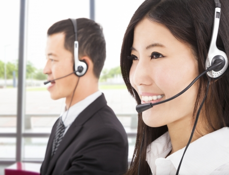 smiling asian businessman with call center agent photo