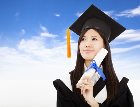 graduate hat: smiling Graduate woman Holding Degree with cloud background