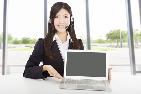 smiling businesswoman with headset and laptop in the office Stock Photo - 18394766