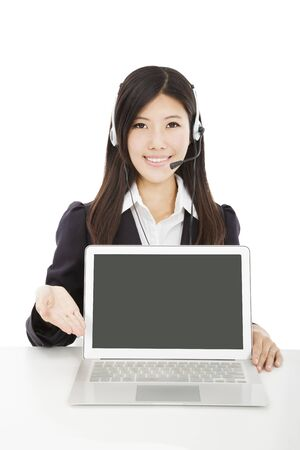 Young  smiling businesswoman with headset and laptop isolated on white photo