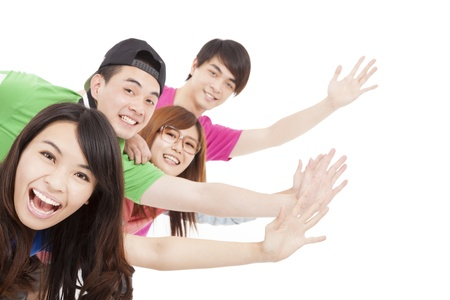 happy  young group with hands up photo