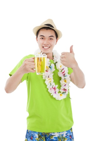 happy young man drinking beer at summer time photo