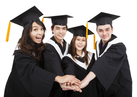 graduate hat:  happy  young graduate students group with success gesture