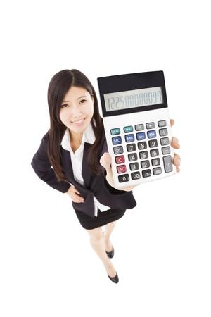 smart business woman holding calculator photo