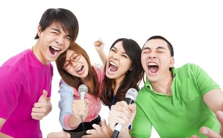 karaoke singer: happy young group having fun singing with karaoke