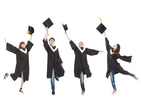 gorros de graduacion: feliz estudiantes de posgrado joven grupo