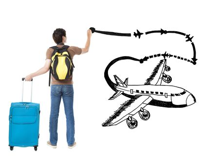 young traveler drawing airplane and airline path on the white background photo
