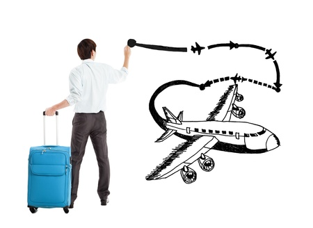young businessman drawing airplane and airline path on the white background photo