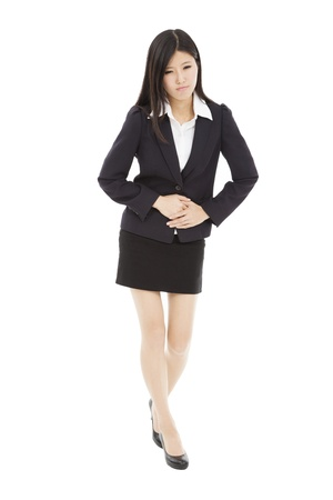 stomachache: young business woman with stomach ache Stock Photo