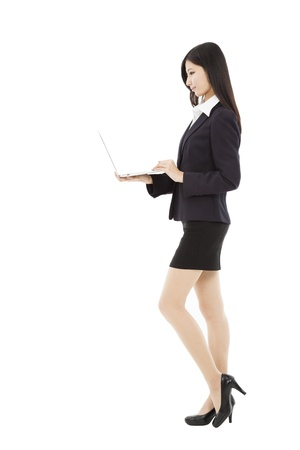 side view young  business woman holding laptop  photo