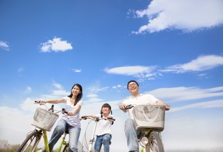 happy family riding bicycle with cloud background Stockfoto