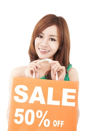 happy  woman showing shopping bag with sale written Stock Photo - 18912754