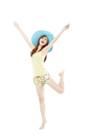 happy young woman dancing in summer during vacation isolated on white photo