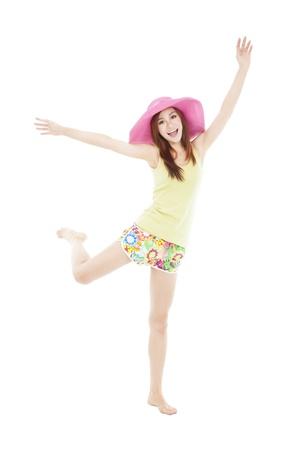 happy young woman dancing in summer during vacation photo