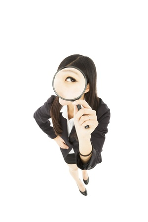 Young business Woman holding Magnifying Glass photo