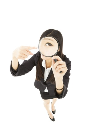 businessWoman holding Magnifying Glass and pointing photo