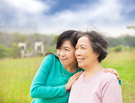 asian old woman: happy young woman  with her mother Stock Photo
