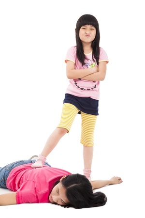 troublesome: troublesome girl and tired mother lying on the floor Stock Photo