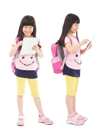 kid friendly: happy little girl student touching tablet pc
