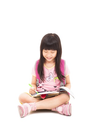 kid sitting: happy asian little girl sitting and reading a book