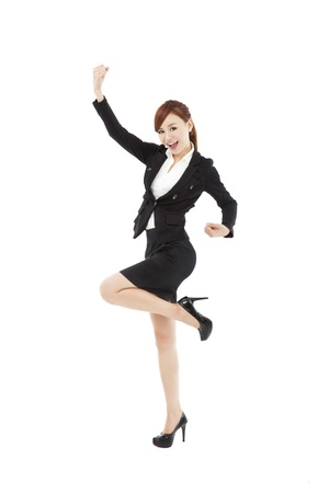 happy young businesswoman with success gesture Stock Photo - 19223426
