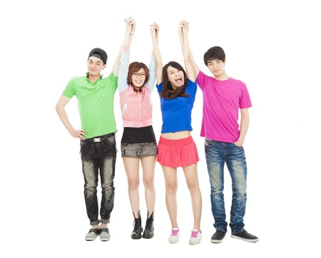 youth background: happy  young group standing together with hands up  Stock Photo