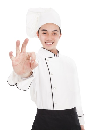 young asian chef with ok gesture photo