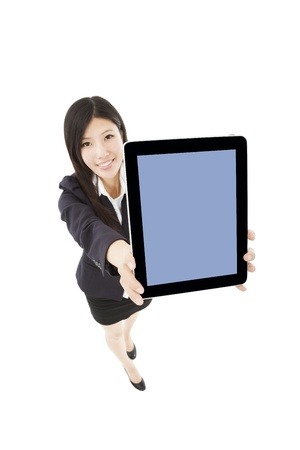 young businesswoman standing and showing tablet pc  photo