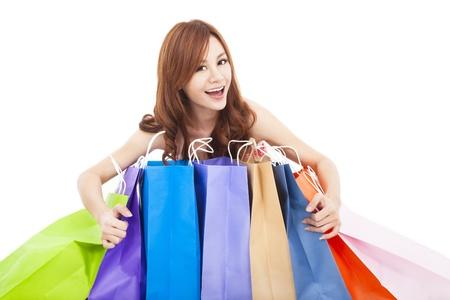 beautiful young woman holding  shopping bags photo