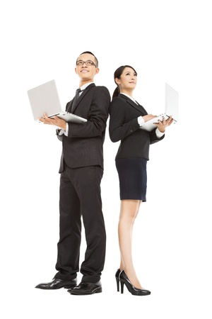 business partner: young business man and woman holding laptop  Stock Photo