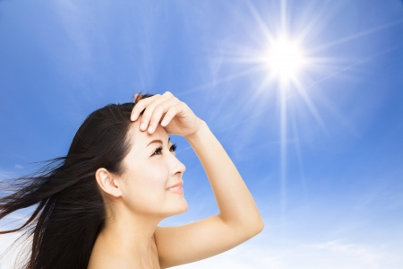 beautiful young woman with sunlight background. summer skin care concept photo