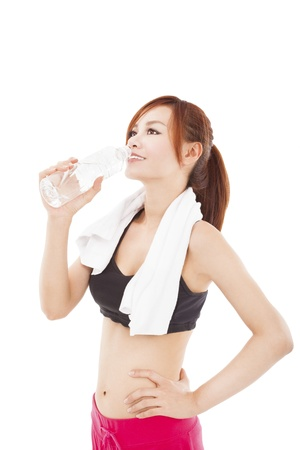 sporty young woman drinking water after workout photo