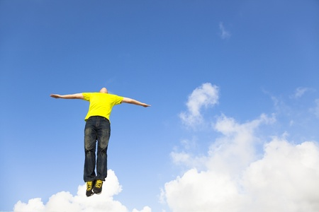 air jump: relaxed young man jumping  Stock Photo