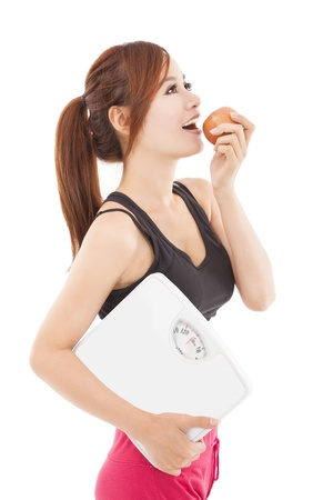 Beautiful young healthy woman eating apple photo