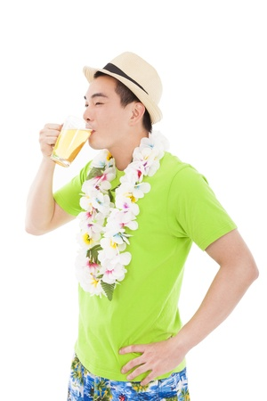 happy young man drinking beer at summer photo