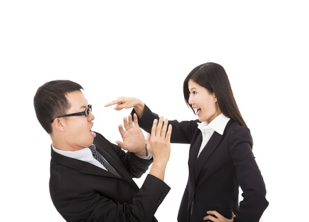 Young business woman angry with her colleague photo