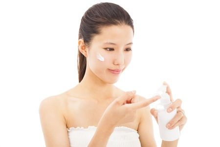 young beautiful face of woman applying moisturize cream photo