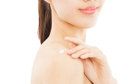 shoulder of young woman applying moisturize cream Stock Photo - 19761735