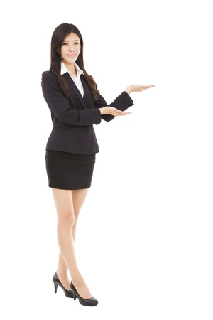 Smiling business woman presenting Stock Photo - 19807464