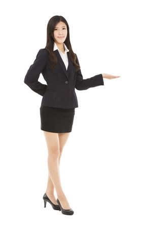 Smiling asian businesswoman presenting photo
